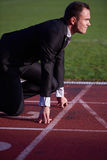 Business man ready to sprint Royalty Free Stock Images