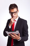 Business man reaing news on his pad Stock Images