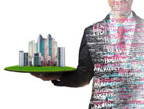 Business man and real estate in hand Stock Image
