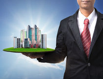 Business man and real estate in hand Stock Photography