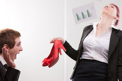 Business man receiving lovely red high heels shoes Royalty Free Stock Photo