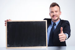 Business man recommends a blackboard Royalty Free Stock Photography