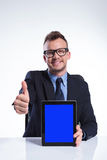 Business man recommends his tablet Royalty Free Stock Image