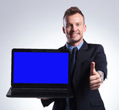 Business man recommends you his laptop Royalty Free Stock Photography