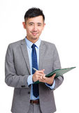 Business man record on clipboard Stock Photo