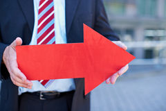 Business man with red arrow. Pointing to the right Stock Images