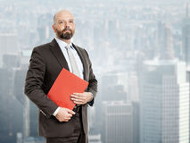 Business man with red folder Stock Images