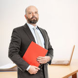 Business man with red folder Royalty Free Stock Image