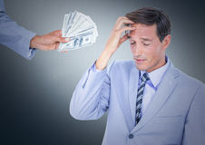 Business man refusing money against navy background Royalty Free Stock Image