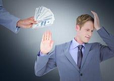 Business man refusing money against navy background. Digital composite of Business men refusing money against navy background Stock Photos
