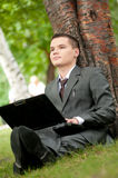 Business man relax with notebook at park. Student Royalty Free Stock Photography