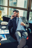 Business man relaxed at work Stock Photos
