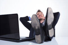 Business man relaxes at the laptop Stock Images