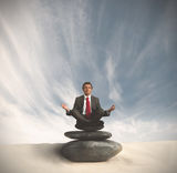 Business man relaxes on the stone Royalty Free Stock Images