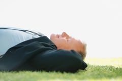 Business man relaxing on the grass Royalty Free Stock Photos