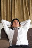 Business man relaxing at home Stock Image