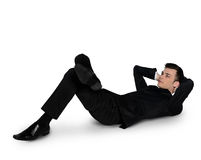 Business man relaxing looking up Royalty Free Stock Photos
