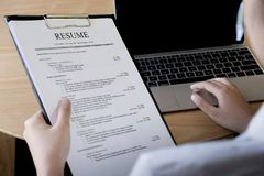 Business man review his resume application on desk royalty free stock photo