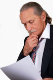 Business man review papers Royalty Free Stock Image