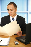 Business Man Reviewing Folder Royalty Free Stock Image