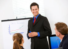 Business: Man Reviews Sales Numbers For Team Stock Image