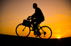 Business man riding bicycle on the hill Royalty Free Stock Image