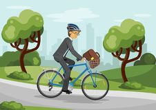 Business man riding bike in helmet Royalty Free Stock Photography