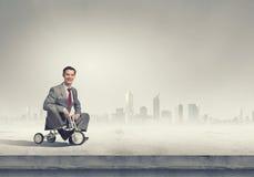 Business man riding bike Stock Image