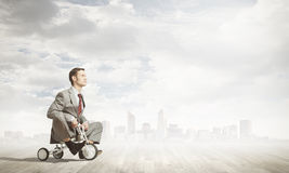 Business man riding bike Royalty Free Stock Photo