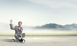 Business man riding bike Stock Images