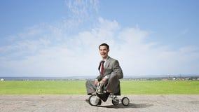 Business man riding bike Stock Photo