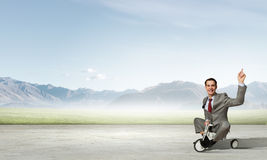 Business man riding bike Stock Photos