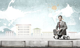 Business man riding bike Stock Photography