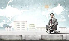 Business man riding bike Stock Photography