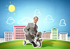 Business man riding bike Royalty Free Stock Images