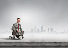 Business man riding bike Royalty Free Stock Photos