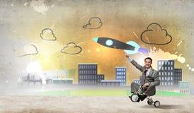 Business man riding bike Royalty Free Stock Image