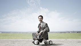 Business man riding bike Royalty Free Stock Photography