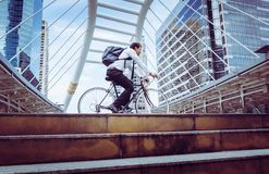 Free Business Man Riding His Bicycle To Work In A Modern City Stock Photography - 126870622