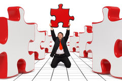 Business man - The right Solution - Red. Happy business man holding a red puzzle in his hands - 3d rendered image combined with photo - Right Solution Concept Royalty Free Stock Photo