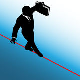 Business Man Risk Tightrope Background. A business man balances with a briefcase, walks a high wire tightrope, above risk and danger, blue background Royalty Free Stock Images