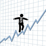 Business man risk tightrope growth chart. A business man climbs up risk tightrope on growth chart Royalty Free Stock Photography