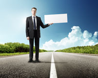 Business man on the road whith blank Royalty Free Stock Photography