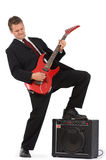 Business man rocking out on red guitar