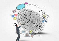 Business man rolling the brain with graphic. Digital composite of Business man rolling the brain with graphic Stock Photos