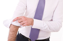 Businessman rolling up sleeves. Stock Image