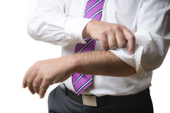 Business Man rolls up sleeves Royalty Free Stock Image