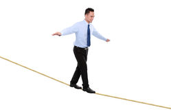 Business man on rope  balancing Royalty Free Stock Image