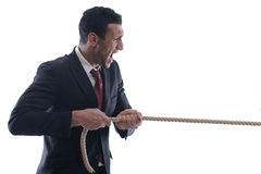 Business man with rope isolated Stock Image