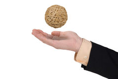 Business man with rubberband ball. In hand isolated on white Stock Photography